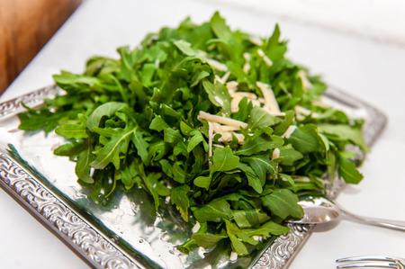 Arugula salad on silver platter