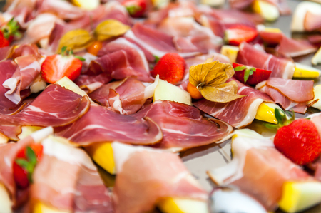 Smoked bacon appetizers on platter