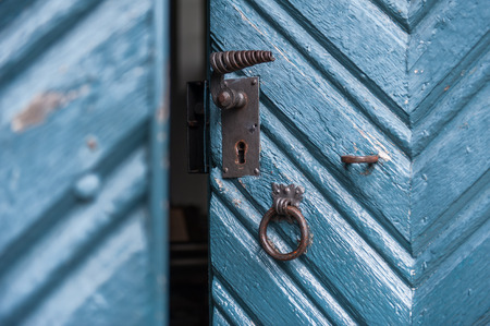 lock on slight open vintage colored door