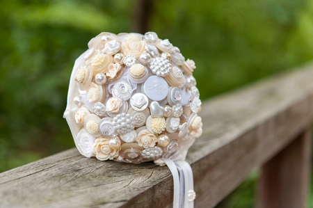 Bride flower bouquet on wooden bridge handlebar