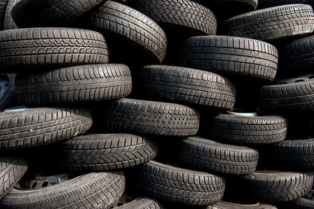 Pile of used tires on scrap yard