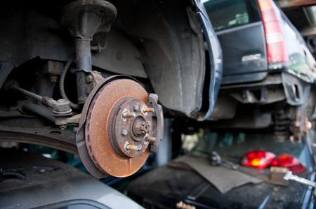 Rusty brake disc on scrap yard Фото со стока