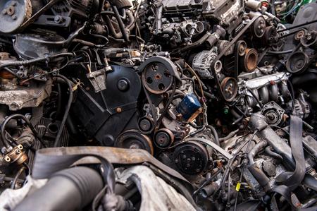 Car engines on a junkyard Фото со стока