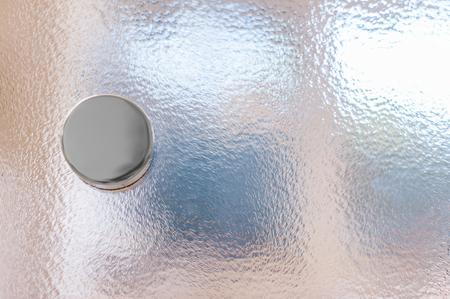 Doorknob on glass door with fine pattern