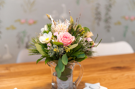 Bouquet of flowers on wooden table Фото со стока