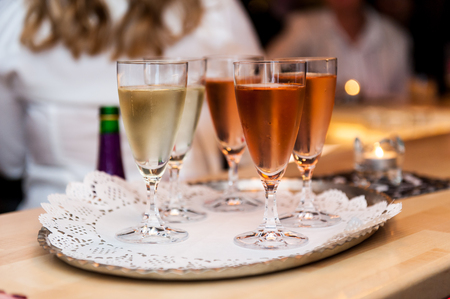 White and rose sparkling wine in glasses