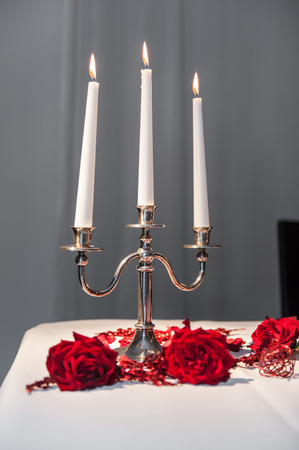 Three candles in a candle holder