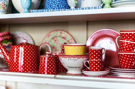 Porcelain cups in wood board