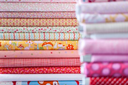 Pile of different textiles Фото со стока