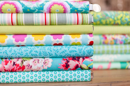 Stack of different colorful fabric rolls