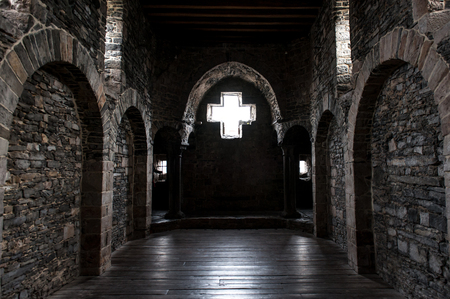 Inside view of arches in a medieval castle Фото со стока