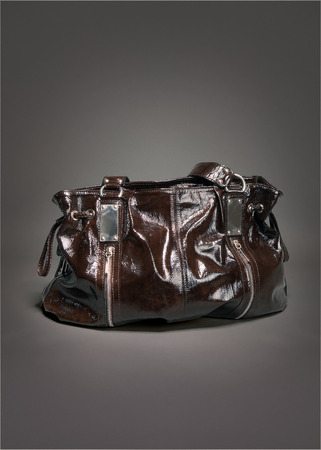 Brown purse leather on gradient gray background