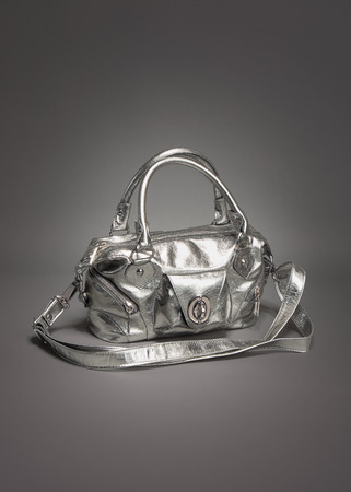 Silver purse / handbag made of leather on gradient gray background