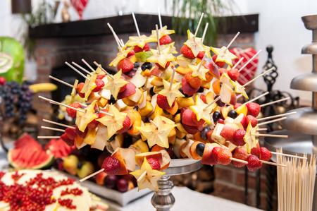 Appetizers on skewers Фото со стока