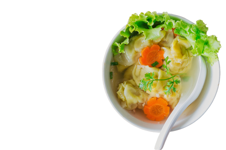 White isolated background homemade delicious minced pork and shrimp wonton dumpling soup in white bowl  top view flat lay. Wonton or dumpling is Chinese food for breakfast lunch or dinner. Stock Photo