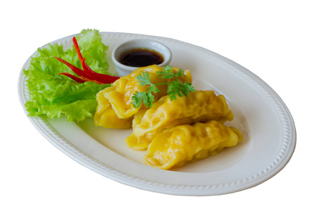 White isolated background with clipping paths homemade minced pork or shrimp dumpling dim sum on white plate served with dipping soy sauce so delicious for breakfast or lunch. Dumpling is Chinese food