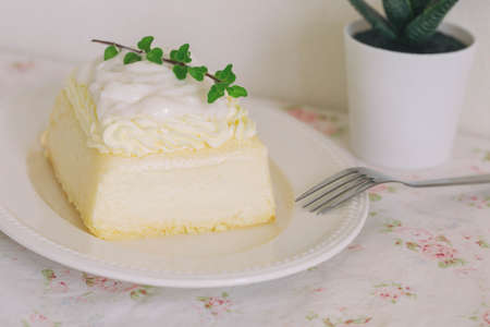 Fresh baked vanilla sponge cake frosting with dairy whipped cream topping with young coconut pudding sauce so sweet and delicious. Exotic asian style dessert. Homemade bakery concept for cafe. 版權商用圖片