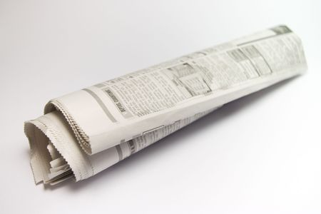 commercial recycling: roll business of newspaper on red background Stock Photo