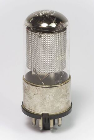 triode: old silver radio bulb on isolated background Stock Photo