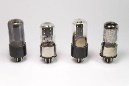 oldies: four type of vintage radio bulbs on white background
