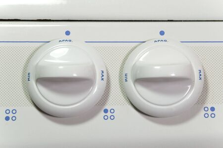 max: two stove buttons with min. and max. power Stock Photo