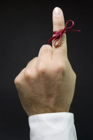 fingers: finger with red ribbon for dont forget