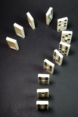 domino game in question expression, over black background photo