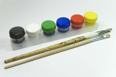 color bottles cole and brushes for artistic paintings photo
