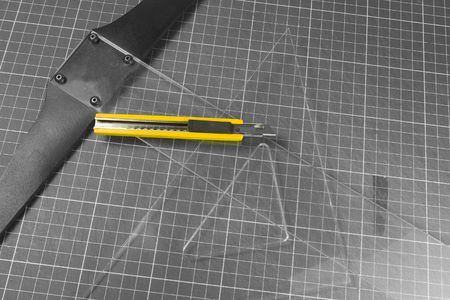 cutter: square, t-rule and yellow cutter knife on black and white
