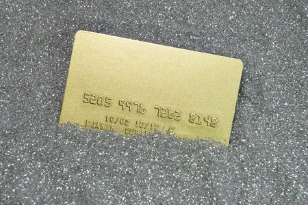 boodle: gold credit card on silver texture of dots Stock Photo