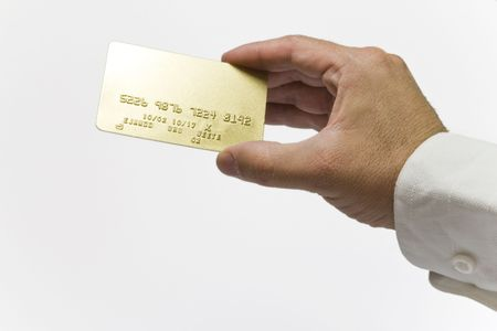 boodle: hand showing a gold credit card on isolated backgrund