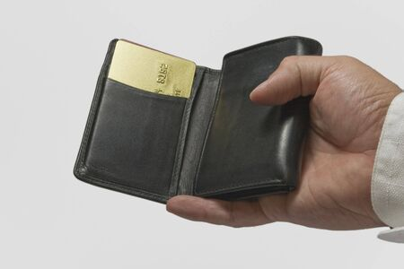 hand holging a black wallet and gold credit card Stock Photo - 2160419
