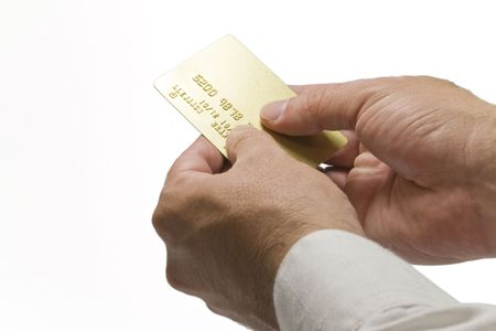 Hands holding a gold credit card on isolated backgrund Stock Photo - 2160417
