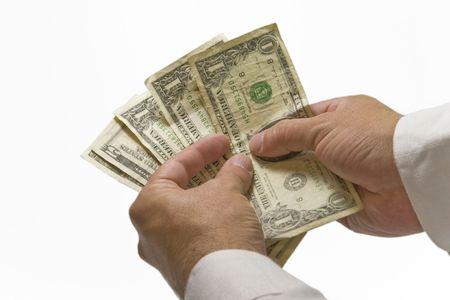 Dos manos contando el dinero en blanco backgrund  Foto de archivo - 2192790