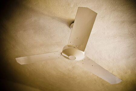 ceiling: ceiling fan in hotel room in brown colors