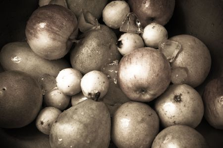 natural fresh fruits with ice on sepia tone photo