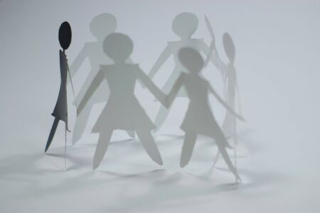businessteam: shadow figures of women group join Stock Photo