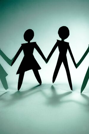 businessteam: shadow figures of woman and men group join Stock Photo