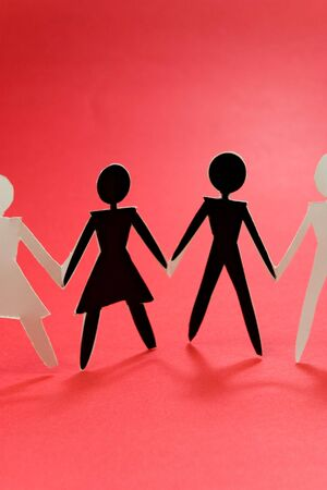 shadow figures of woman and men group join on red  photo