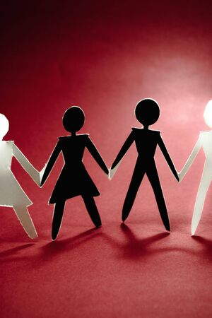 businessteam: shadow figures of woman and men group join on red