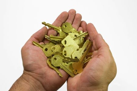 human hands with gold keys  isolated photo