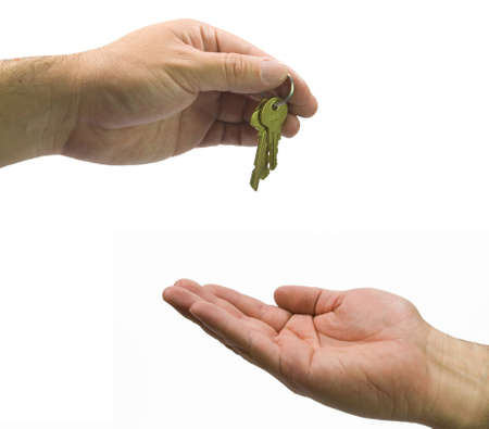 one hand giving keys to other isolated photo