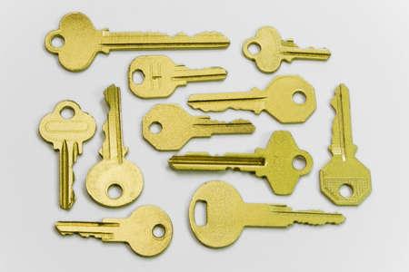 a lot of golden keys on white background photo