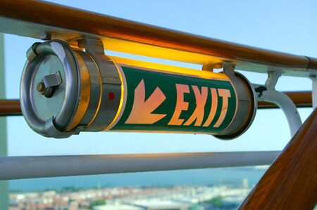 exit sign of ligth on a cruise stairs photo
