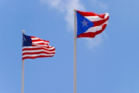 puerto rico: usa and puerto rico flags on blue sky