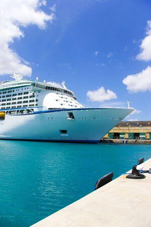 cruise ship anchored in a caribbean pier