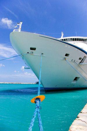 ship anchor: cruise ship anchored in a caribbean pier   Stock Photo