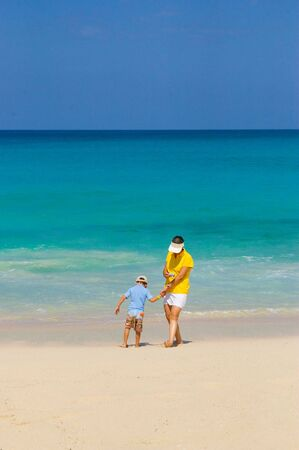 woman and boy playing in caribbean beach photo