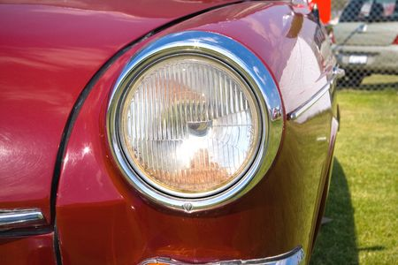 front bumper: headlight in vintage european red car front