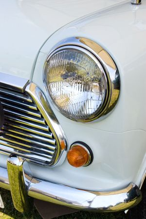mini: headlight in white english mini vintage car